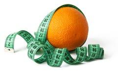Orange Fruit. With measurement isolated on white Royalty Free Stock Images