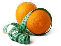 Orange Fruit. With measurement isolated on white Royalty Free Stock Photos