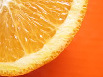 Orange fruit. On the orange background Stock Photo