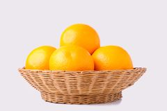 Orange fruit in basket on a white background stock photography