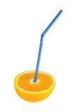 Orange fruit with blue straw Royalty Free Stock Image