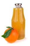 Orange fruit and a bottle of juice Stock Images