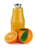 Orange fruit and a bottle of juice Royalty Free Stock Photography
