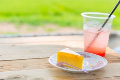 Orange Fruit Cake with Fresh Strawberry Ice Soda. Cool drink healthy dessert for summer stock photography