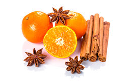 Orange fruit, cinnamon sticks and anise stars Stock Image