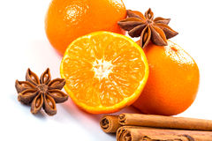 Orange fruit, cinnamon sticks and anise stars Stock Images