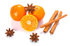 Orange fruit, cinnamon sticks and anise stars Royalty Free Stock Image