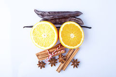 Orange fruit, cinnamon sticks and anise stars isolated on white Royalty Free Stock Image
