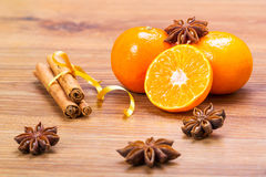 Orange fruit, cinnamon sticks and anise stars Stock Photo