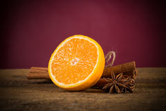 Orange fruit, cinnamon sticks and anise stars Stock Images