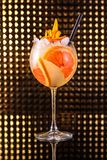 Orange fruit cocktail with grapefruit in tall round glass royalty free stock image