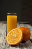 Orange fruit cut and orange juice on wooden table background,. Fresh Orange fruit cut and orange juice on wooden table background royalty free stock photos