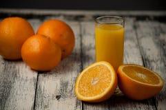Orange fruit cut and orange juice on wooden table background,. Fresh Orange fruit cut and orange juice on wooden table background stock photos