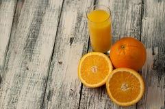 Orange fruit cut and orange juice on wooden table background,. Fresh Orange fruit cut and orange juice on wooden table background stock photo