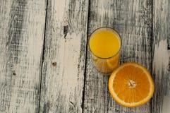 Orange fruit cut and orange juice on wooden table background,. Fresh Orange fruit cut and orange juice on wooden table background stock images