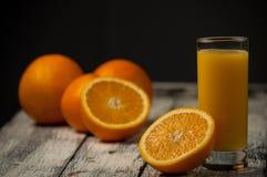 Orange fruit cut and orange juice on wooden table background,. Fresh Orange fruit cut and orange juice on wooden table background royalty free stock photo