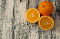 Orange fruit cut and orange juice on wooden table background,. Fresh Orange fruit cut and orange juice on wooden table background royalty free stock images