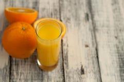 Orange fruit cut and orange juice on wooden table background,. Fresh Orange fruit cut and orange juice on wooden table background stock photography