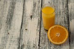 Orange fruit cut and orange juice on wooden table background,. Fresh Orange fruit cut and orange juice on wooden table background stock image