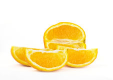Orange fruit with cuts on white Royalty Free Stock Images
