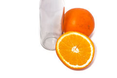 Orange fruit and empty bottle isolated on white background.  Royalty Free Stock Photography