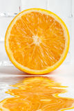 Orange fruit with flood Royalty Free Stock Photo