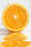 Orange fruit with flood Royalty Free Stock Photo