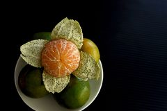 Orange fruit. The orange fruits and fleshy inner part with leathery , oily rind stock photography