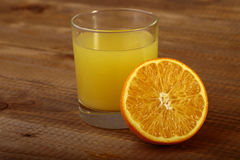 Orange fruit and glass of juice Royalty Free Stock Photo