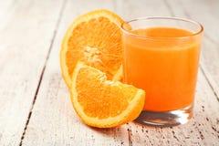 Orange fruit and glass of juice on white wooden background Stock Photo