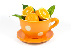 Orange fruit with green leaves in ceramic bowl isolated on white Royalty Free Stock Photo