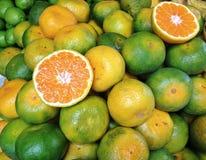 Orange Fruit. Green Orange in Market stock photography