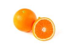 Orange fruit with half isolated on white background Royalty Free Stock Photo