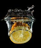 Orange fruit half splash in water stock images