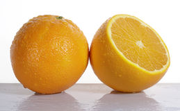 Orange fruit and half. On white background Stock Photography