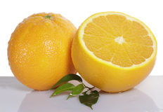 Orange fruit and half Royalty Free Stock Photography