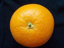 Orange fruit isolated on dark. It was photographed from above Stock Images