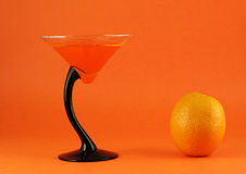 Orange fruit and juice. In a coctail glass Stock Photos