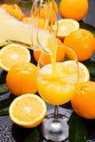 Orange fruit juice. Fresh orange fruit juice poured in a glass Royalty Free Stock Photography