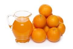 Orange fruit juice in glass jug Royalty Free Stock Image