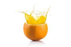 Orange Fruit. Orange juice splashing  on white background Royalty Free Stock Photos