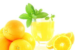 Orange fruit with juice and stevia in white background Stock Images