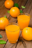 Orange fruit and juice Royalty Free Stock Images