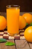 Orange fruit and juice Royalty Free Stock Photos