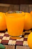 Orange fruit and juice Royalty Free Stock Image