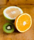 Orange fruit, kiwi and grapefruit Royalty Free Stock Photography