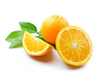 Orange fruit with leaves. Oranges with leaves on white background stock photo