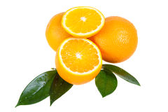 Orange fruit with leaves Stock Photos