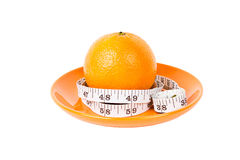 Orange Fruit with measurement tape on orange plate Stock Images