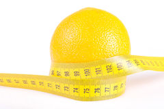 Orange Fruit with measurement on white royalty free stock photography
